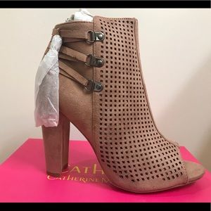 Perforated ankle boots